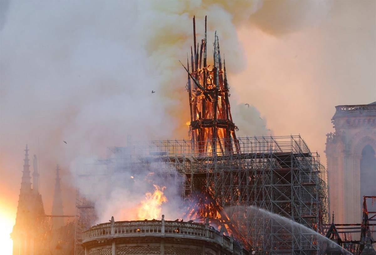 huge fire engulfs notredame cathedral in paris the fatu